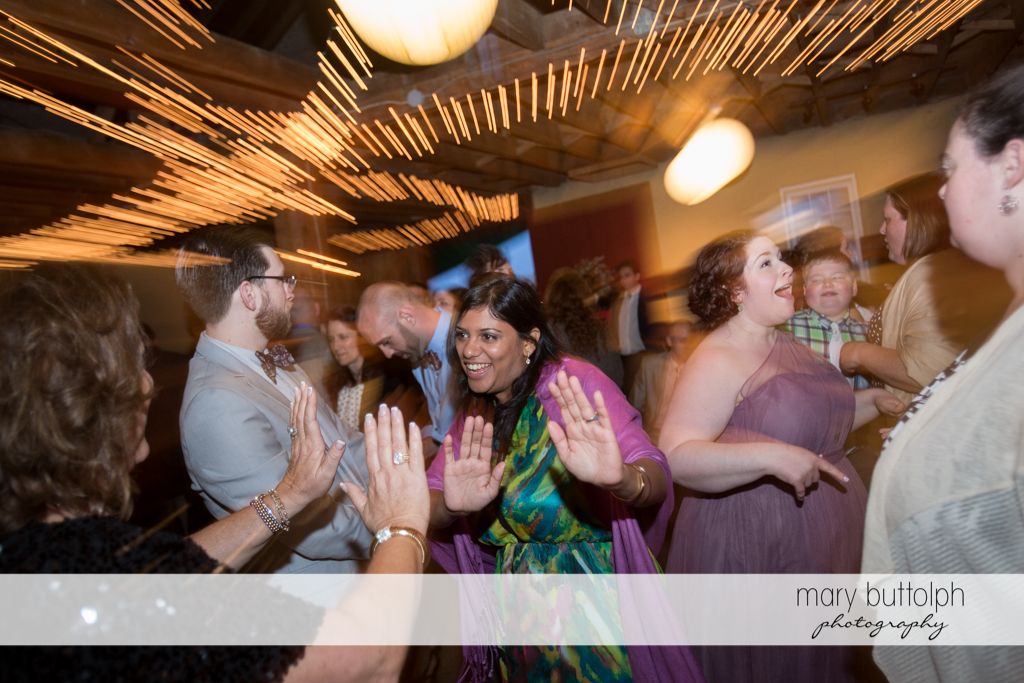 Guests dance the night away at the wedding venue at Frog Pond Bed & Breakfast Wedding