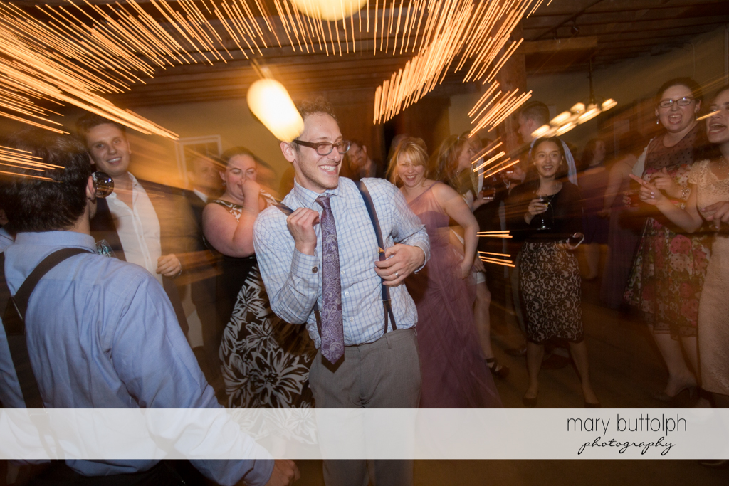 Groom and guests liven up the dance floor at Frog Pond Bed & Breakfast Wedding