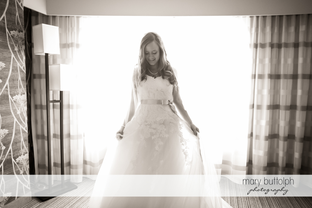 Bride is bathed in sunlight at the Lodge at Welch Allyn Wedding