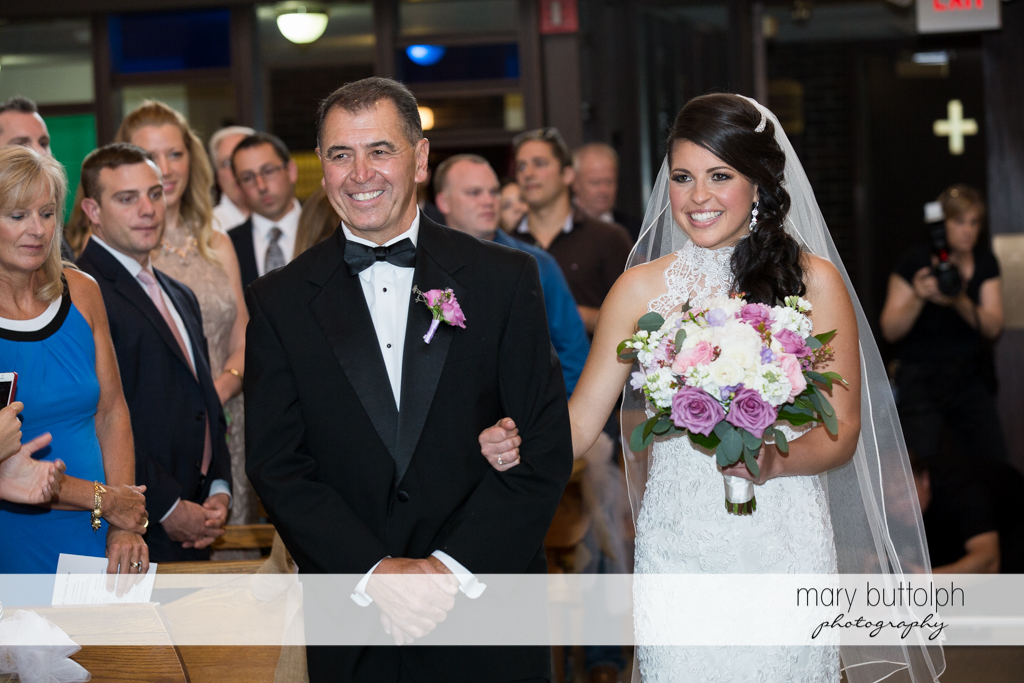 Bride walks down the aisle with her father at the Lodge at Welch Allyn Wedding