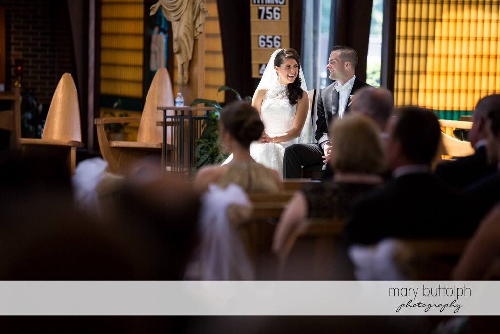 Couple sit near the altar at the Lodge at Welch Allyn Wedding