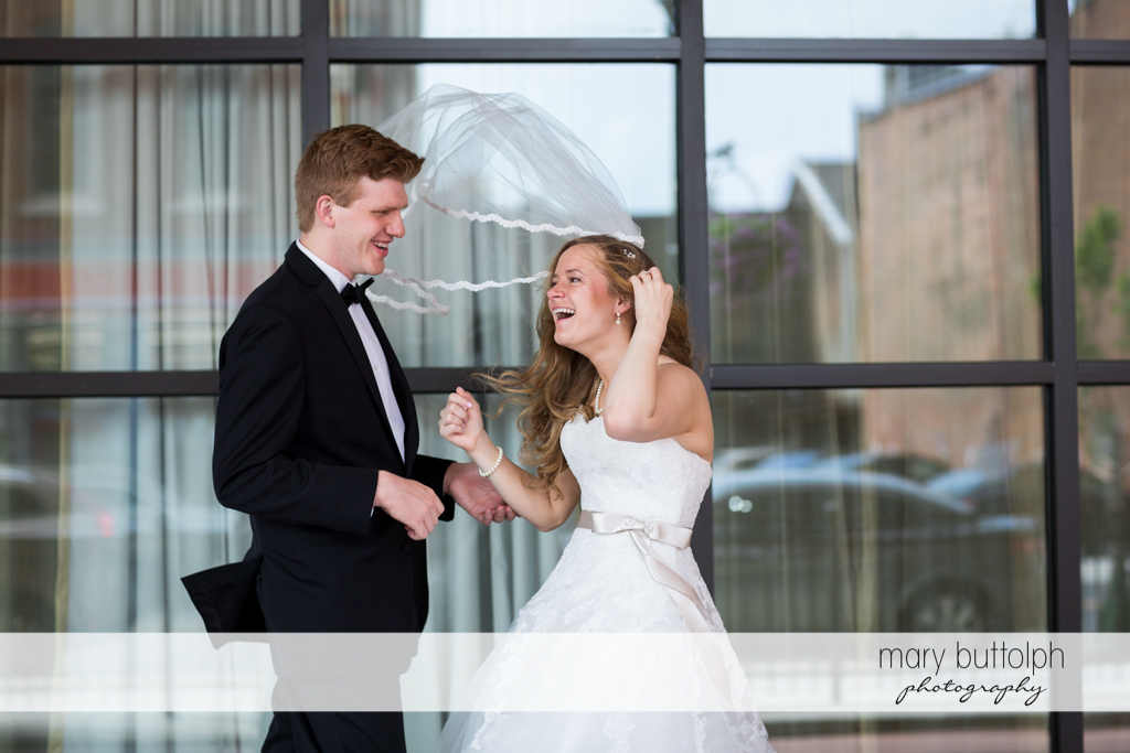 Couple share a laugh at the Lodge at Welch Allyn Wedding