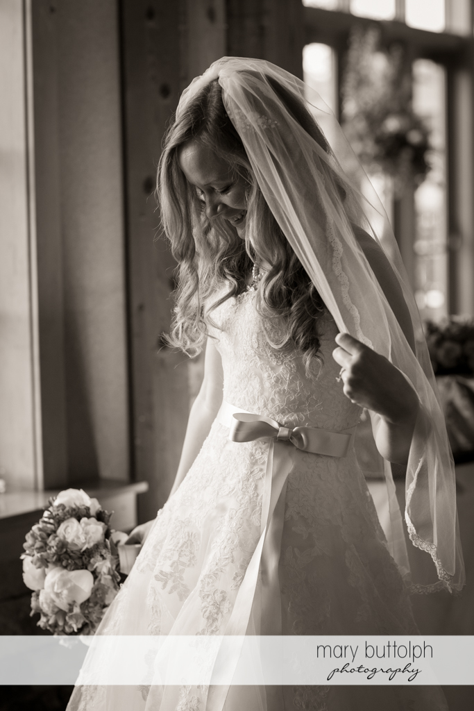 Bride admires her wedding dress at the Lodge at Welch Allyn Wedding