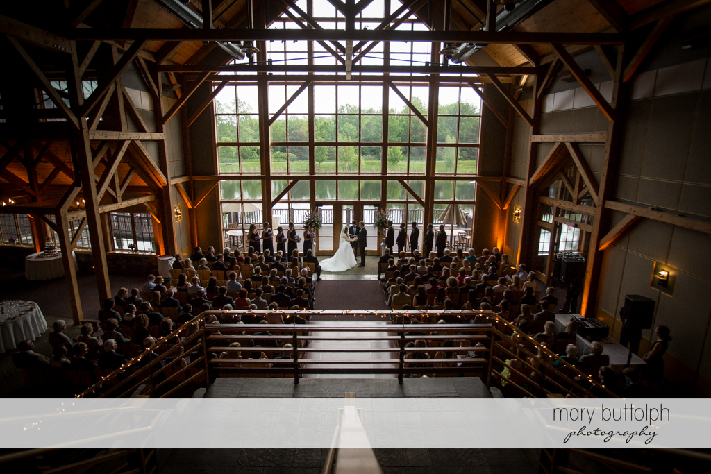 Long shot of the couple in front of the marriage officiant at the Lodge at Welch Allyn Wedding