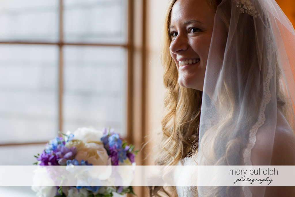 Bride smiles for the camera at the Lodge at Welch Allyn Wedding