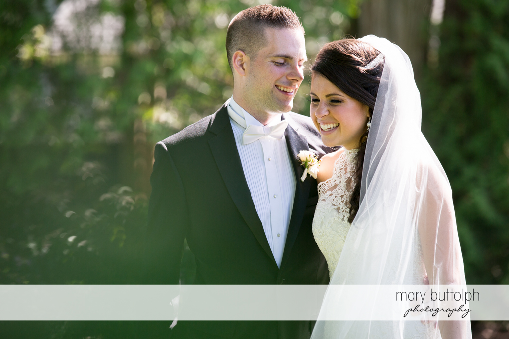 Couple share a tender moment in the garden at the Lodge at Welch Allyn Wedding