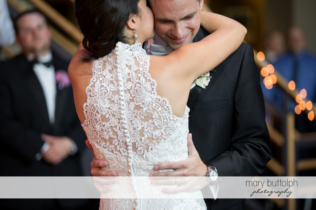 Bride embraces the groom at the wedding venue at the Lodge at Welch Allyn Wedding