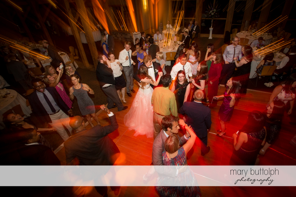 Guests dance at the wedding venue at the Lodge at Welch Allyn Wedding