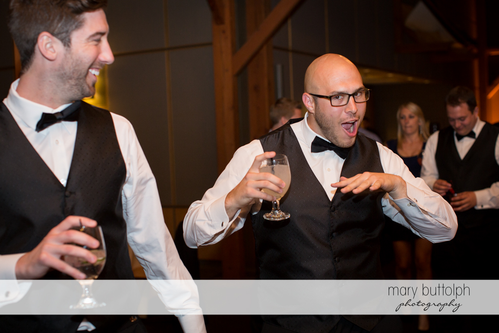 Guests clown around during the wedding reception at the Lodge at Welch Allyn Wedding