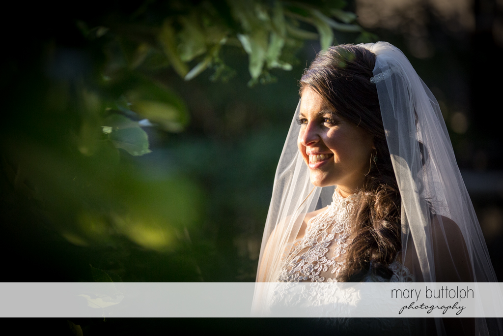 Solo shot of the bride in the garden at the Lodge at Welch Allyn Wedding