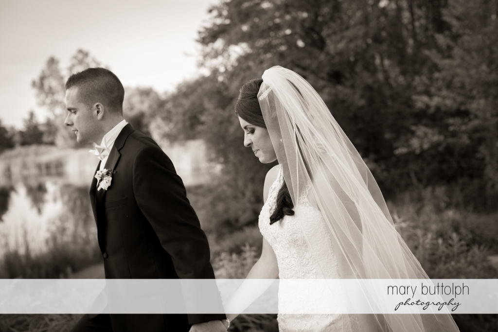 Couple walk in the woods at the Lodge at Welch Allyn Wedding