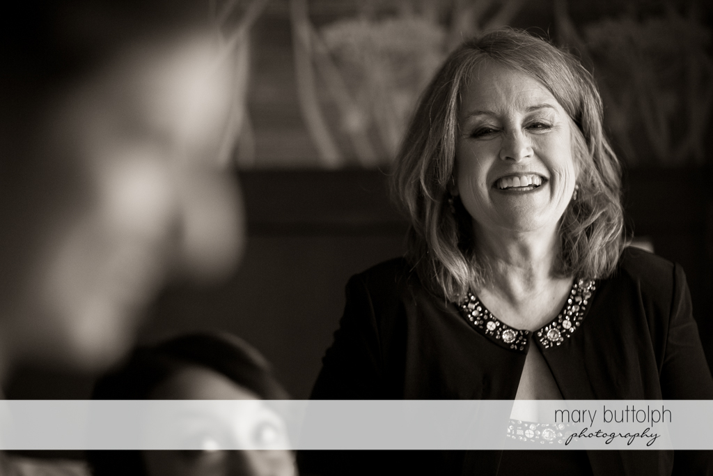 Bride's mother smiles at the Lodge at Welch Allyn Wedding