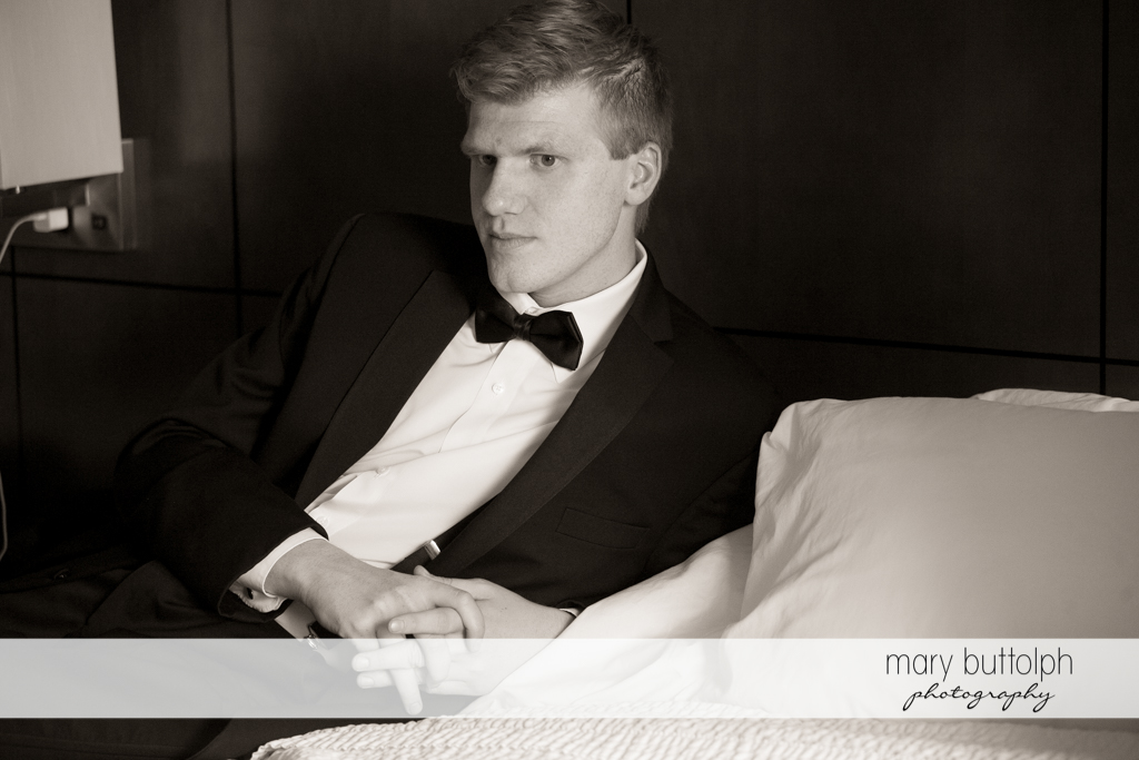 Groom in a serious mood at the Lodge at Welch Allyn Wedding