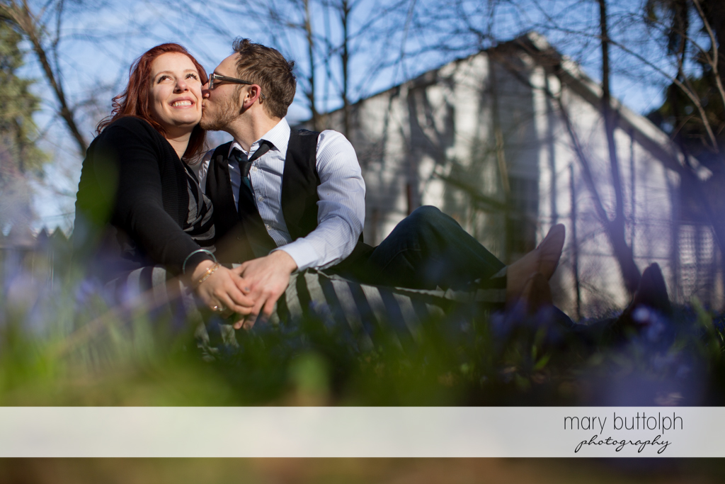 Couple share a tender moment at the park at Skaneateles Engagement