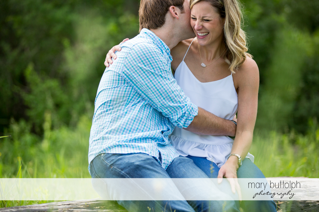 Couple share happy moments in the park at Skaneateles Engagement