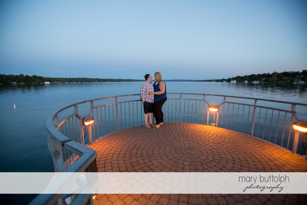 Couple spend quality time by the lake at Skaneateles Lake Engagement