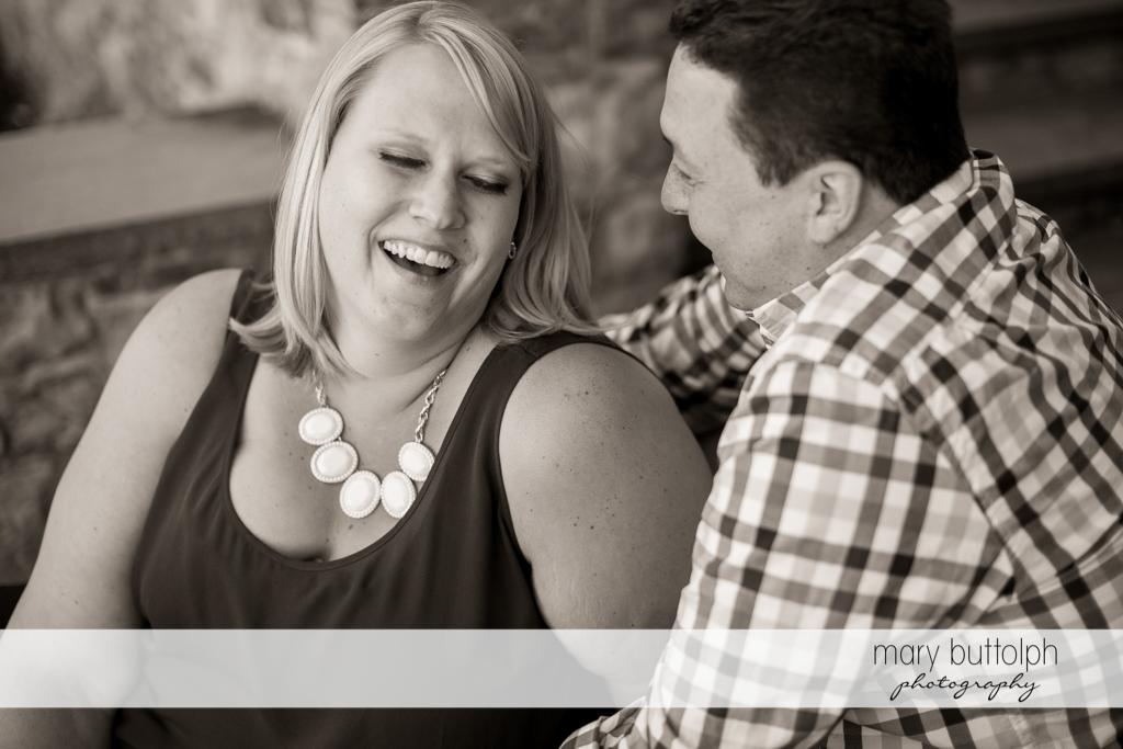 Couple enjoy a good laugh at Skaneateles Lake Engagement