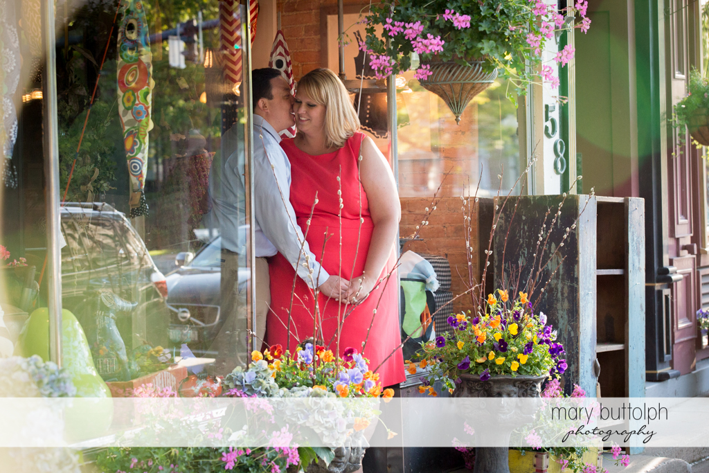 Couple visit a store decorated with flowers at Skaneateles Lake Engagement