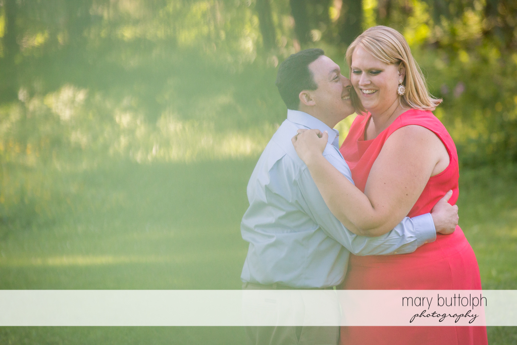 Couple embrace in the park at Skaneateles Lake Engagement