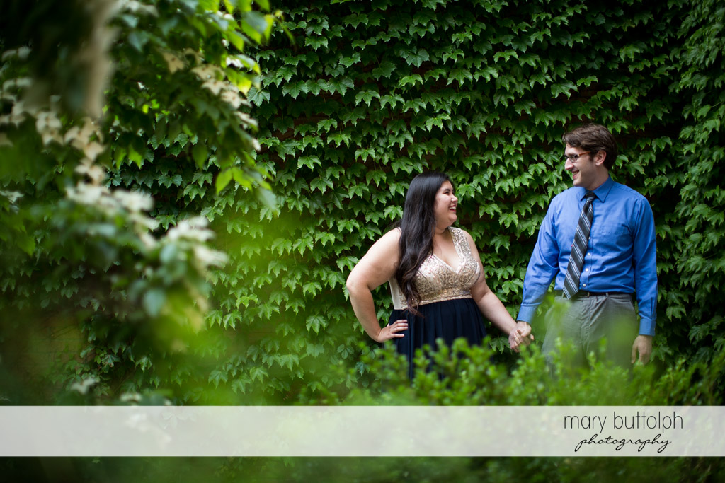 Couple stroll in the garden at Aurora Inn Engagement