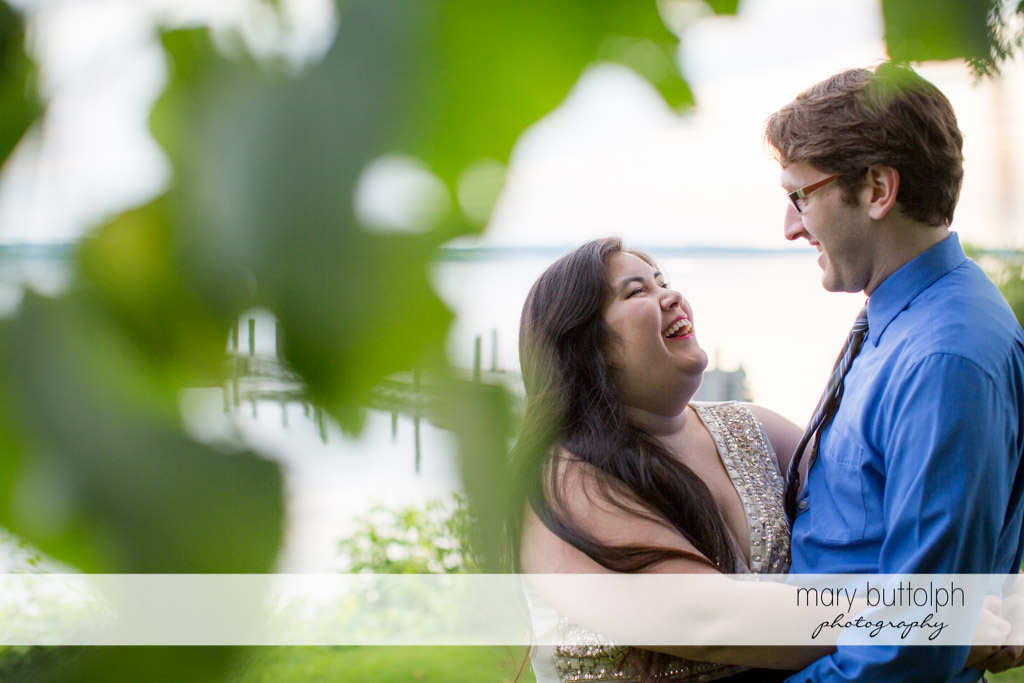Couple share happy times by the lake at Aurora Inn Engagement