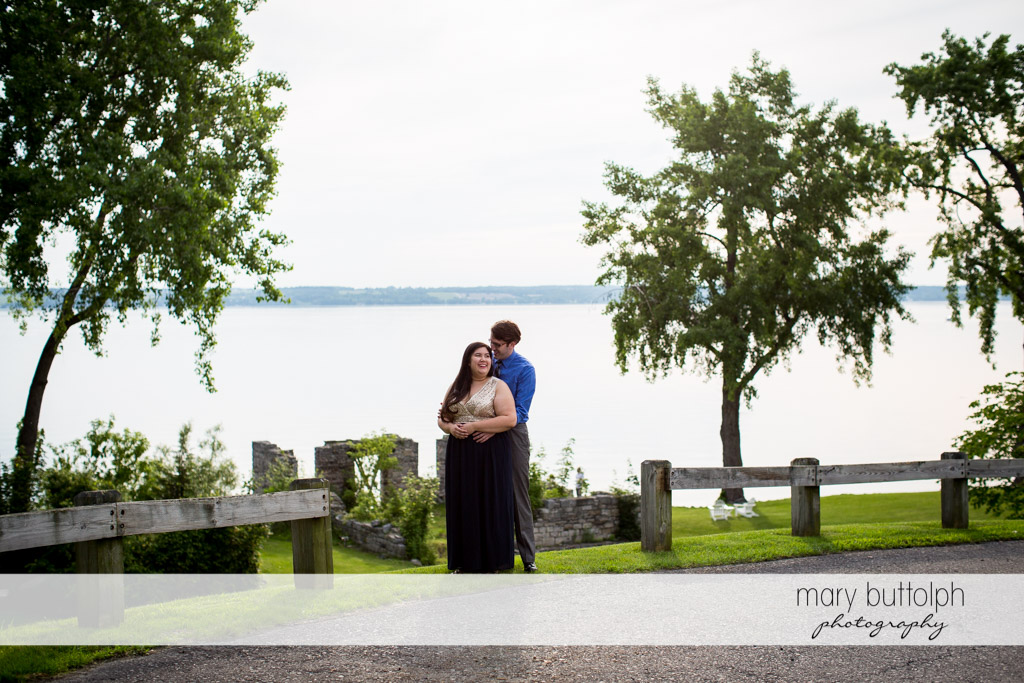 Couple cuddle up near the lake at Aurora Inn Engagement