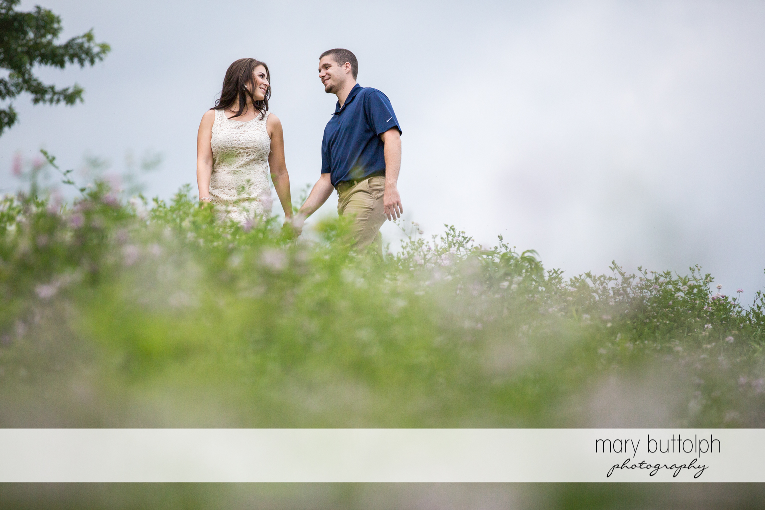Couple stroll in the garden at Skaneatles Engagement
