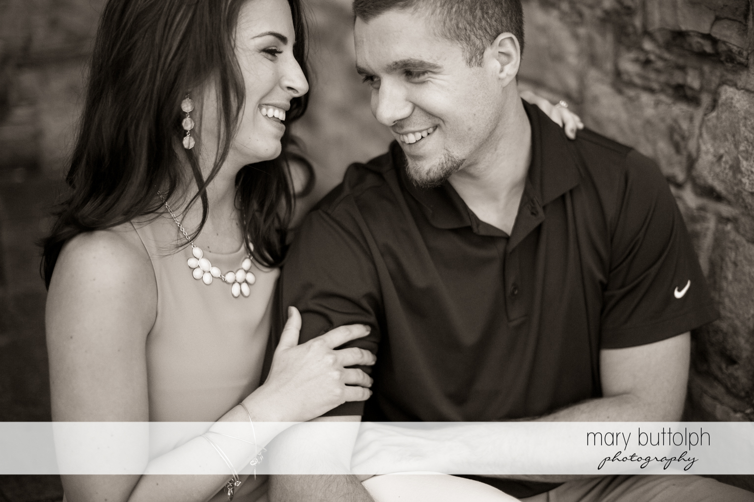 Couple in a light mood at Skaneateles Engagement