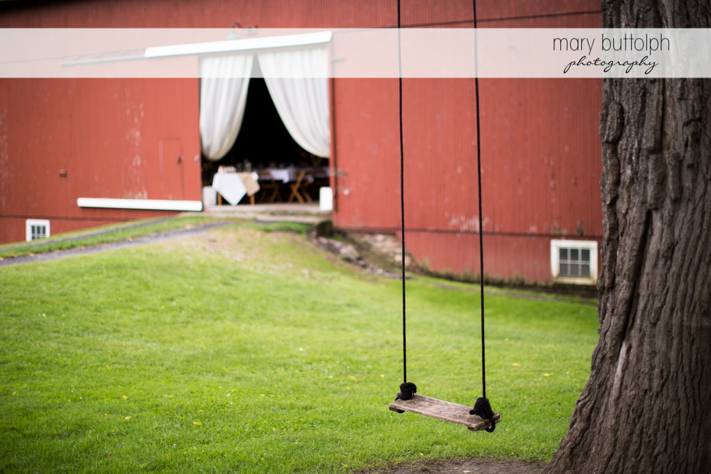 An empty swing is found near the entrance to the wedding venue at Mandana Barn Wedding