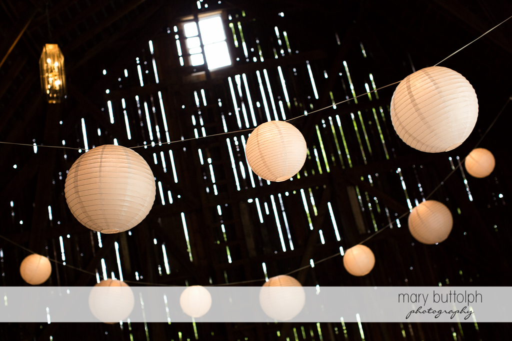 Chinese lanterns hang from the ceiling at Mandana Barn Wedding