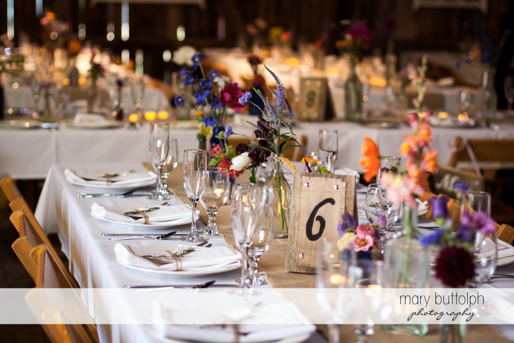 Tables await guests at the wedding venue at Mandana Barn Wedding