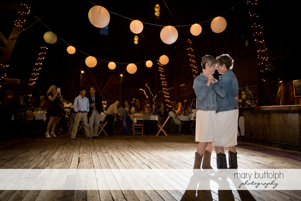 Same sex couple in a romantic dance at Mandana Barn Wedding