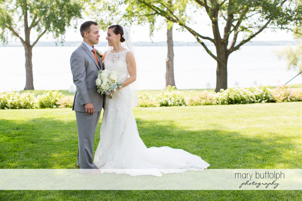 Couple pose in the garden by the lake at the Inns of Aurora Wedding