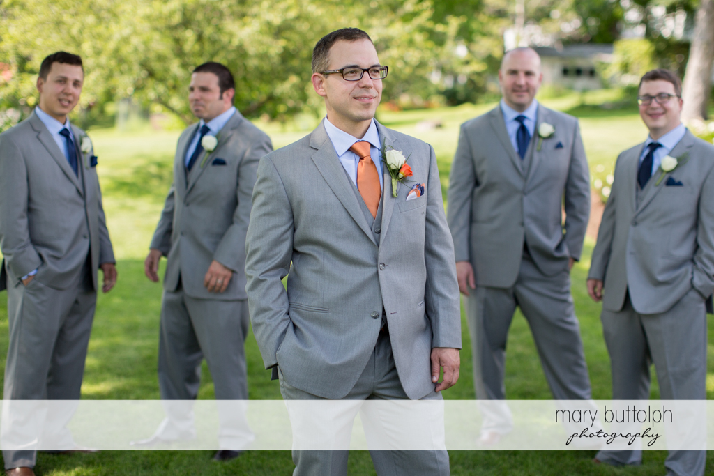 Groom and groomsmen in the garden at the Inns of Aurora Wedding