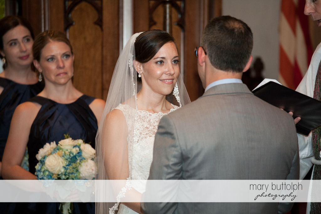 Bride faces the groom in church at the Inns of Aurora Wedding