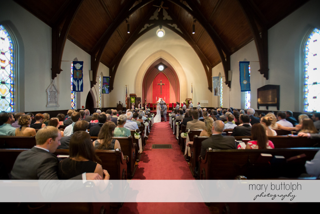 Long shot of the couple in front of the altar at the Inns of Aurora Wedding