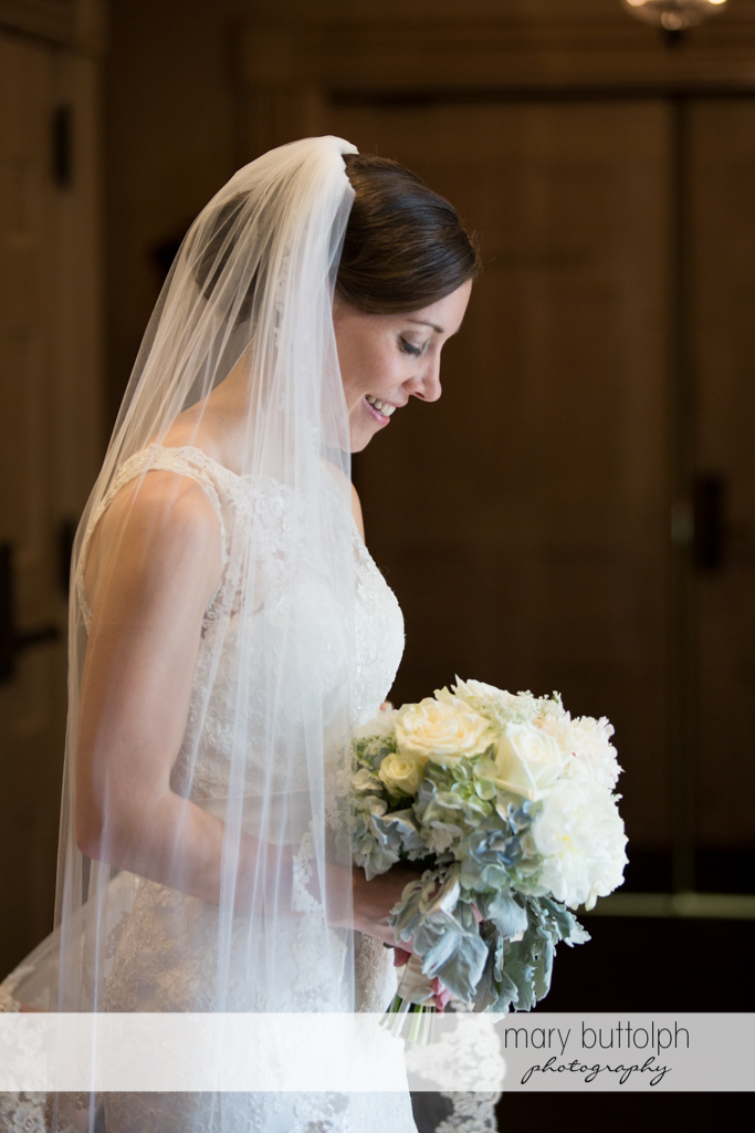 Bride looks at her beautiful bouquet at the Inns of Aurora Wedding