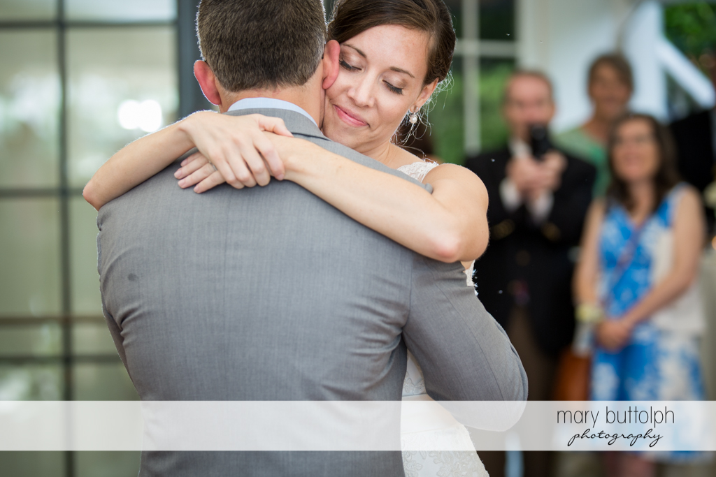 Couple embrace in front of guests at the Inns of Aurora Wedding