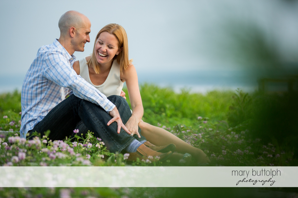 Couple relax in the park at Aurora Engagement