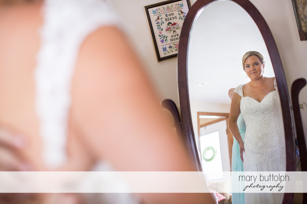 Bride faces the mirror in her room at Emerson Park Pavilion Wedding