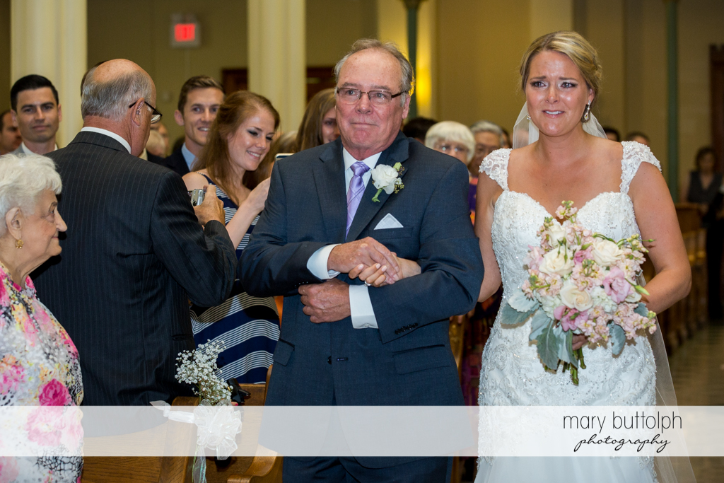 Bride is teary-eyed as she walks down the aisle with her father at Emerson Park Pavilion Wedding
