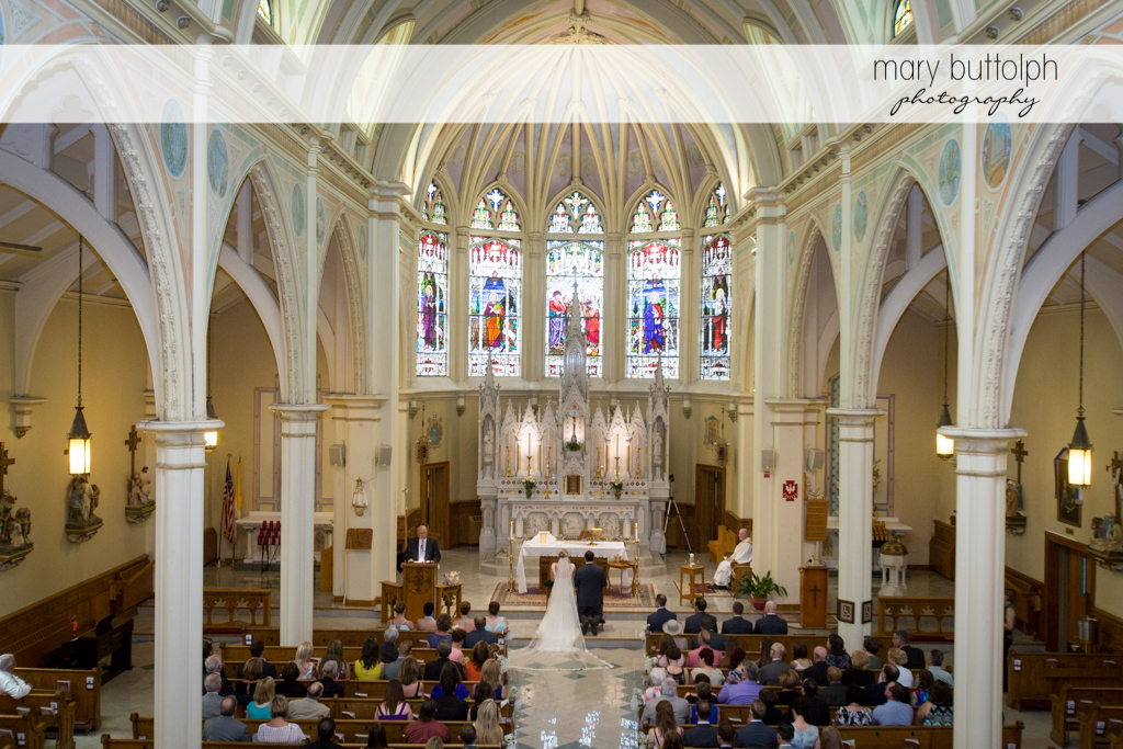 Church interior with the couple in front of the altar at Emerson Park Pavilion Wedding
