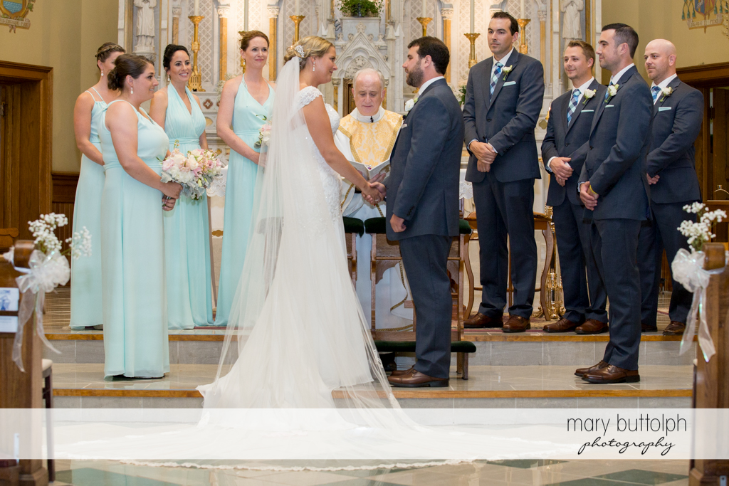 The wedding party with the priest at the altar at Emerson Park Pavilion Wedding