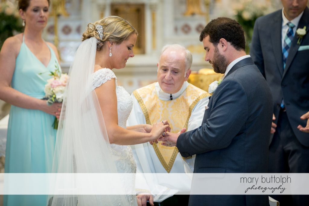 Priest guides the couple during the wedding ceremony at Emerson Park Pavilion Wedding