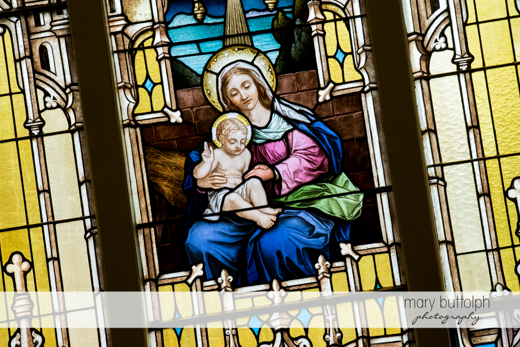 Stained glass window in church shows the Virgin Mary and Baby Jesus at Emerson Park Pavilion Wedding