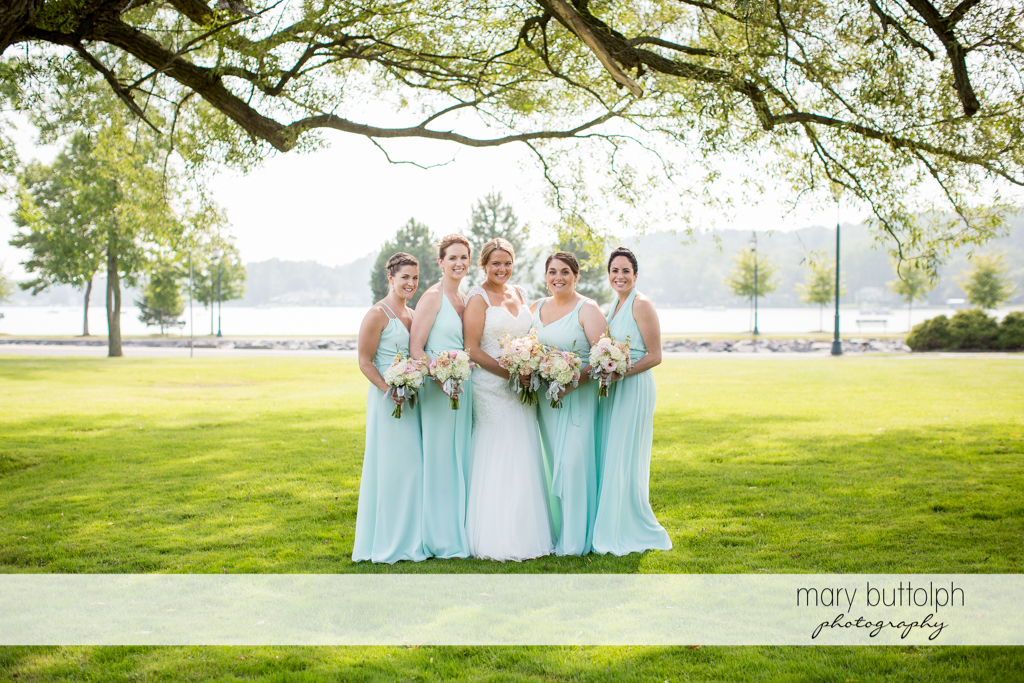 Bride and bridesmaids in the garden at Emerson Park Pavilion Wedding