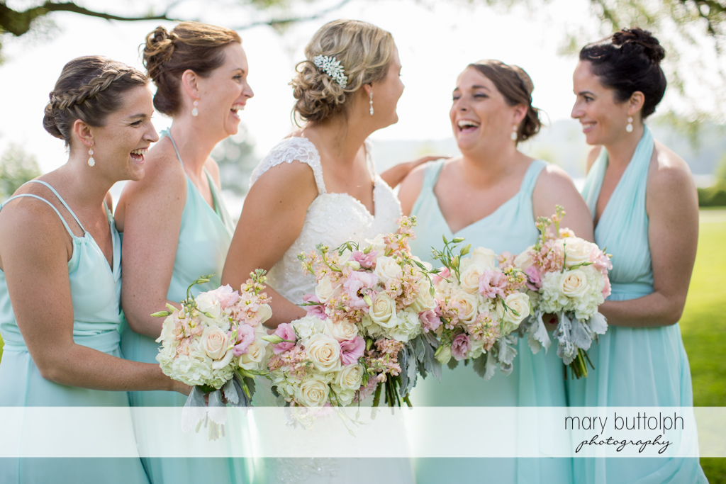 Bride shares a light moment with bridesmaids at Emerson Park Pavilion Wedding