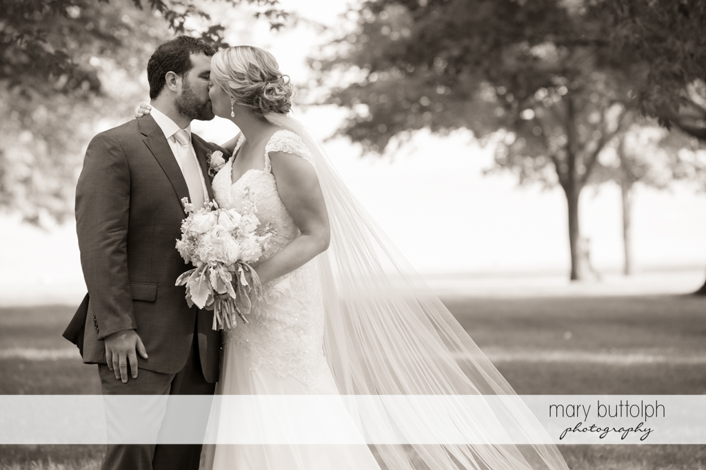 Couple kiss in the garden at Emerson Park Pavilion Wedding