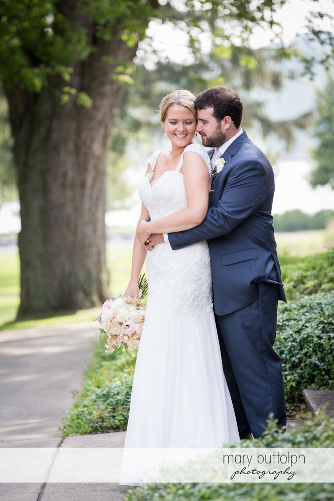 Couple pose near a tree at Emerson Park Pavilion Wedding