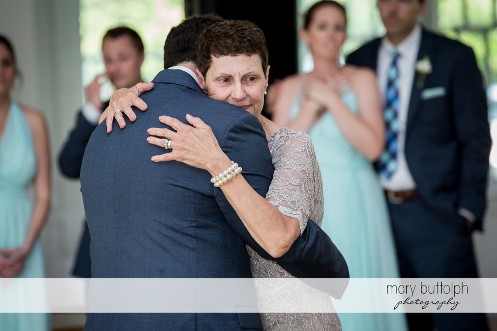 Groom embraces his mother at the wedding reception at Emerson Park Pavilion Wedding